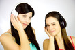 Two young women listening music with headset