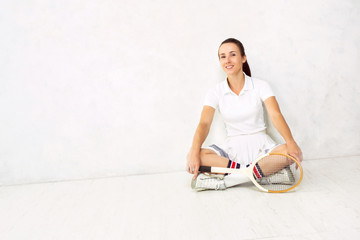 Young beautiful girl with a tennis racket in and in sportswear s