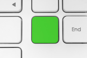 Blank green button on the keyboard close-up.