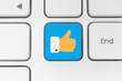 Blue like button on keyboard.