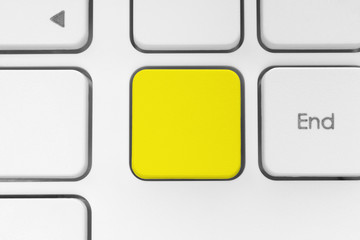 Blank yellow button on the keyboard.