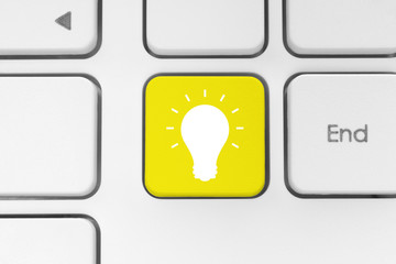 Yellow keyboard button with idea concept.