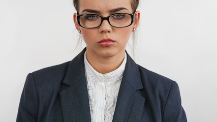 Disappointed young woman with glasses