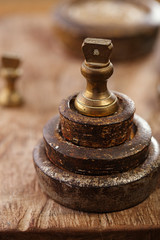 Vintage  iron and brass kitchen  weights on wood