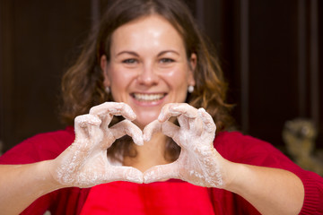 woman showing heart sign