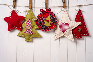 Christmas tree ornaments on wood background with copy space
