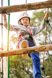 Boy on the rope track in adrenalin park poster