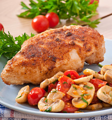 Chicken fillet in crispy breadcrumbs garnished with mushrooms an