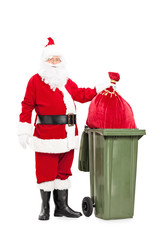 Santa Claus throwing away his bag of presents