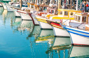 Colorful sailing boats at Fishermans Wharf of San Francisco