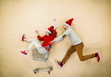 Christmas couple with trolley on beige background - 72632634