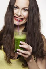 Portrait of a Woman Drinking Green Fruit Juice