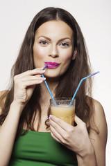 Portrait of a Woman Drinking Fruit Juice