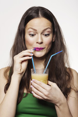 Portrait of a Woman Drinking Fruit Juice