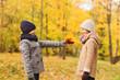 smiling children in autumn park