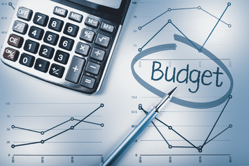 Budget calculation, pen, calculator and graphs