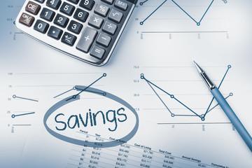 Savings calculation, pen, calculator and graphs