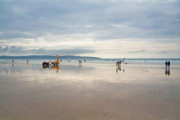 Lifeguard on Gwithian beach in Cornwall, UK.