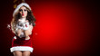 sexy Weihnachtsfrau pustet Schnee