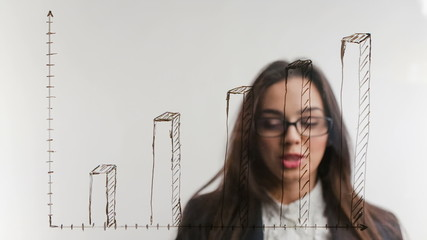 Business woman on background of increasing graph