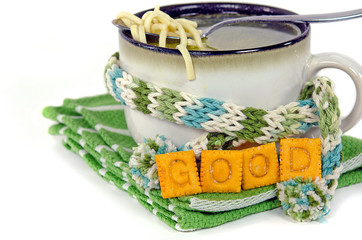 chicken noodle soup in cup with scarf