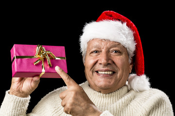 Joyous Old Man Pointing At Magenta Wrapped Gift