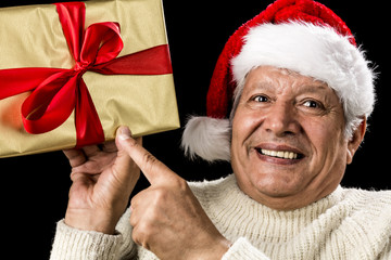 Excited Aged Man Pointing At Golden Gift In Hand