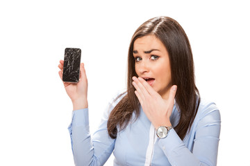 Young woman with broken smartphone.