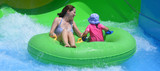 Mother and child having fun in water park
