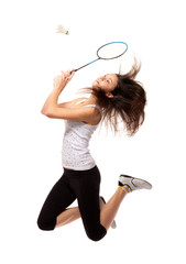 Beautiful girl holding badminton rackets isolated on white