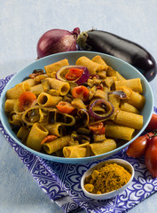 pasta with eggplants  tomatoes and curry