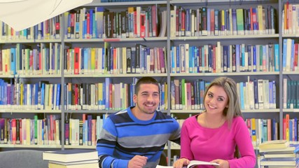 Young students at photoshooting in library