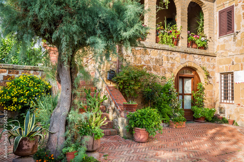 Beautiful porch in the ancient town in Tuscany - 72642417