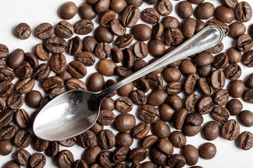 Teaspoon and coffee beans