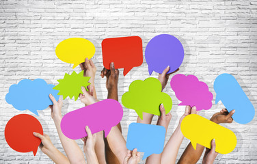 Group of Human Arms Raised with Speech Bubbles