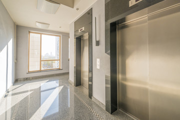 entrance of a residential building with an elevator