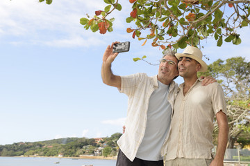 Gay couple taking a selfie with mobile phone