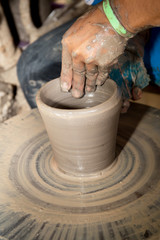 close up photo of child hands in potter craft