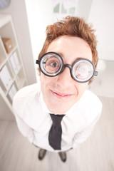 happy nerd clerk with big glasses