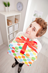 clerk with a big gift in wide-angle
