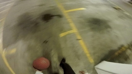 First person view of someone bouncing a basketball