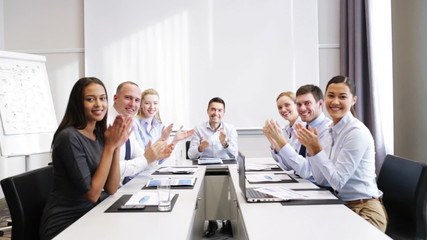 smiling business people meeting in office