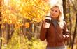 Autumn Woman with Coffee Cup. Fall. Blonde Beautiful Girl