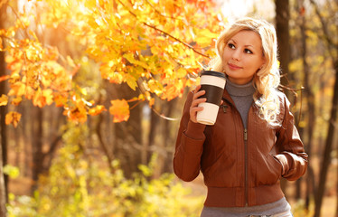 Autumn Woman with Coffee Cup. Fall. Blonde Beautiful Girl