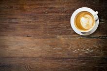 """Постер, картина, фотообои """"latte coffee on wood with space."""""""