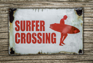Retro Surfer Crossing Sign On Wooden Background