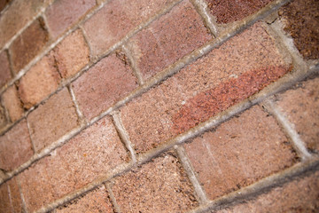 Shallow DOF perspective of weathered red bricks in Sydney, Austr