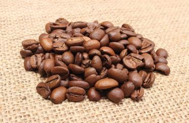Heap of coffee on jute background