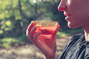 Woman drinking tea outside