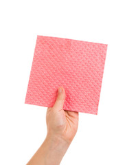 Hand holds pink cleaning sponge
